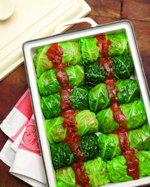 Pork-stuffed cabbage rolls with slightly tart tomato-bacon sauce ...